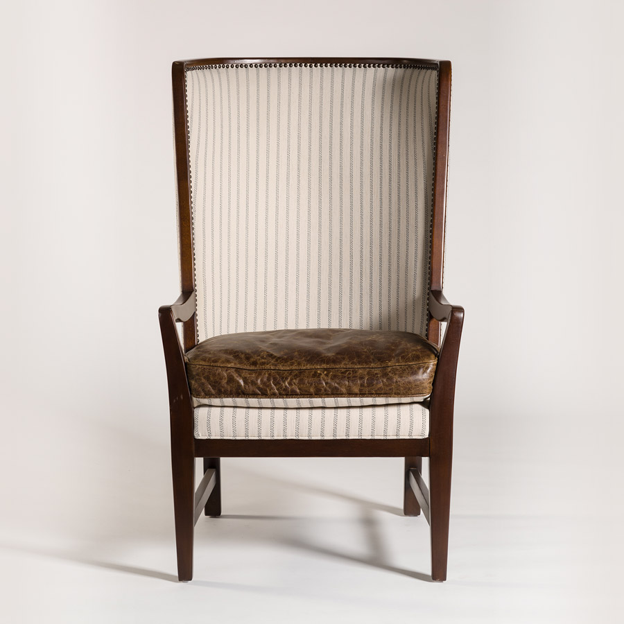 Queen Anne chair with leather seat and cream striped upholstered back