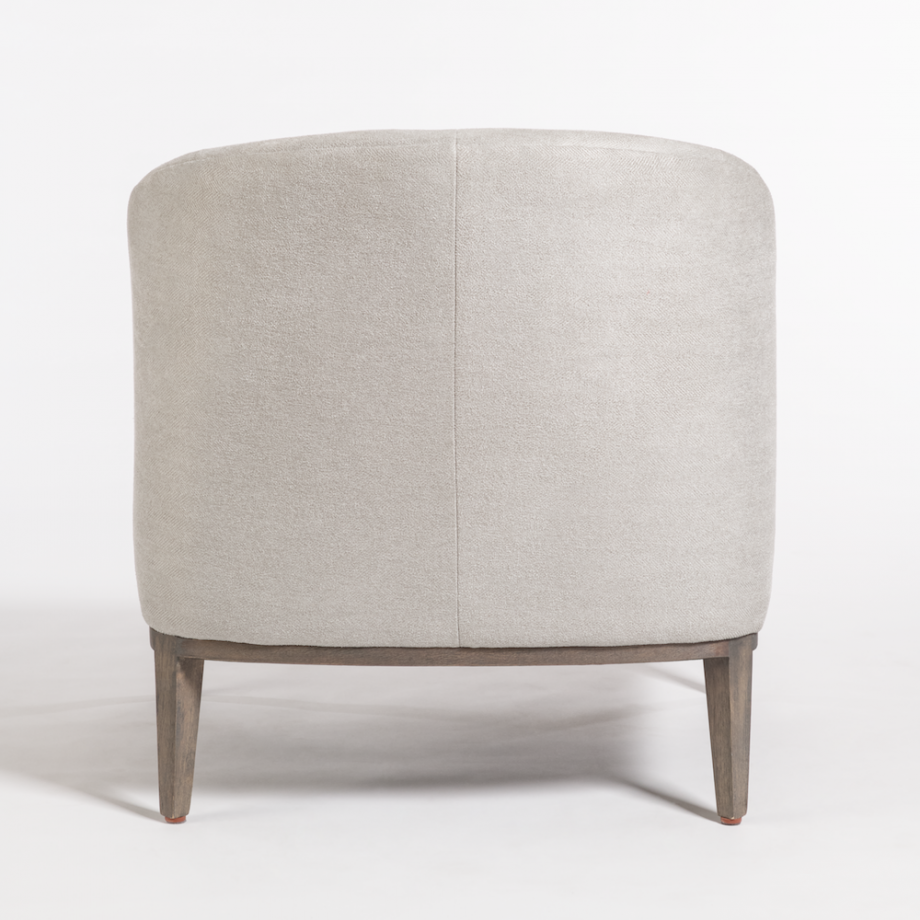 Upholstered occasional chair with low arched back