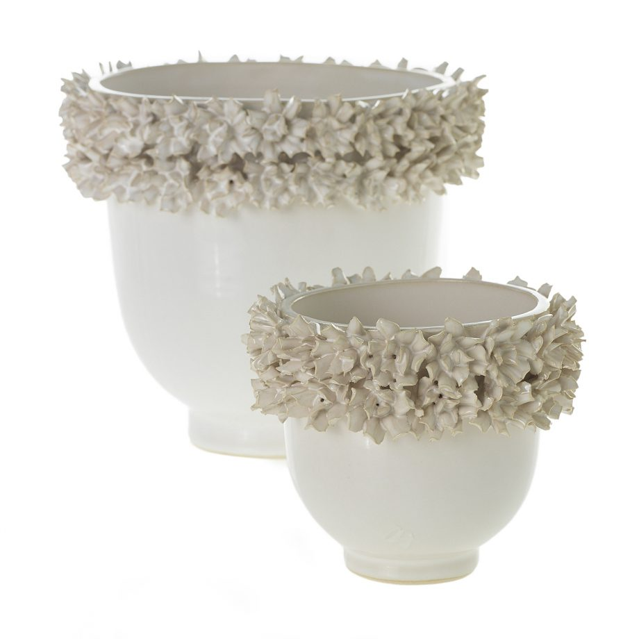 White ceramic vase with floral texture top rim