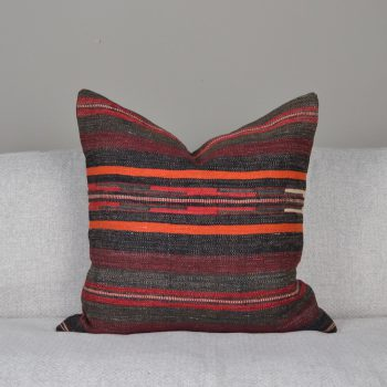 red gray and orange southwest pillow made from vintage turkish rug textiles