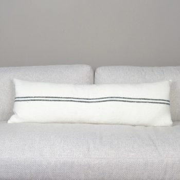 white lumbar pillow with two thin black stripes