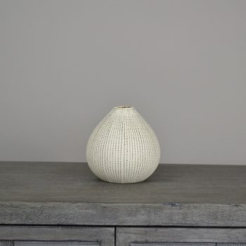 white budvase with black painted dots