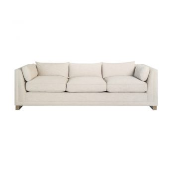 cream sofa with angled upholstered sides