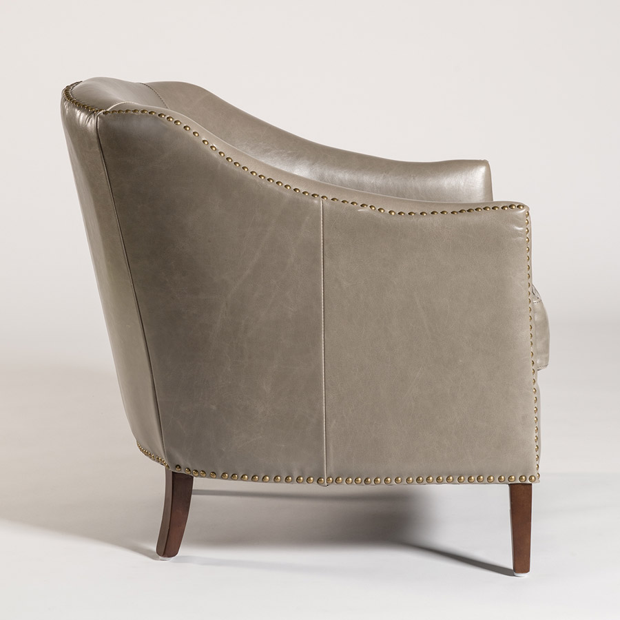 gray leather club chair with nailhead