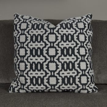 dark gray pillow with white textured pattern
