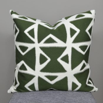 green and white geometric blot pattern pillow