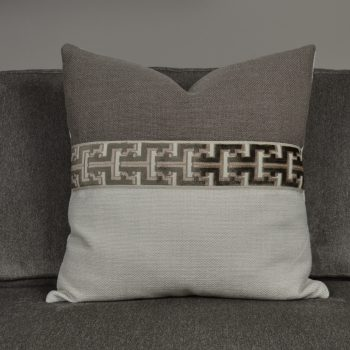 light and dark brown pillow with greek key stripe
