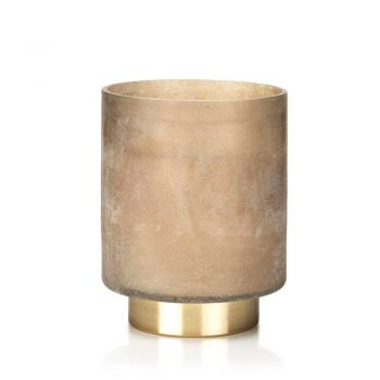 tobacco flower scented candle in taupe glass jar with brass base