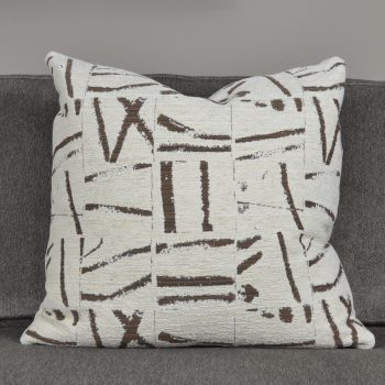 white pillow with brown pattern fragments