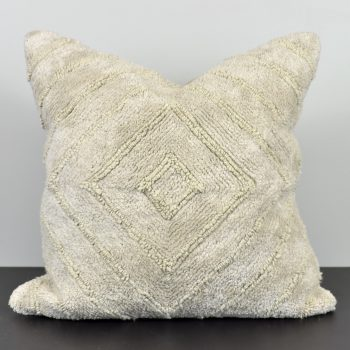 beige sand pillow with embroidered concentric diamond pattern