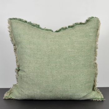 green linen pillow with fringe