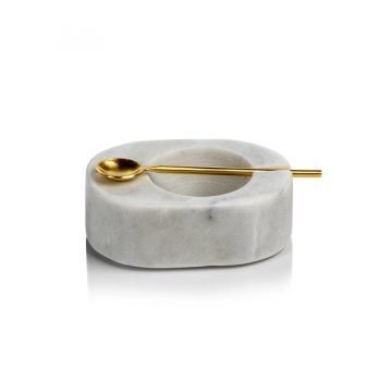 white marble salt dish with gold spoon